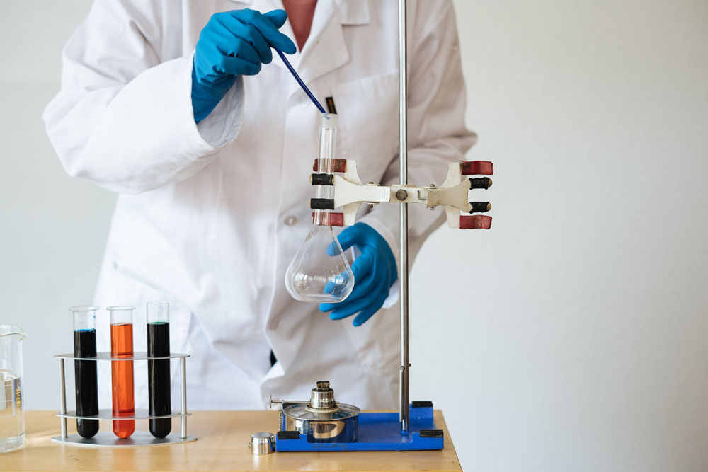 faceless-laboratory-technician-conducting-chemical-test-3825368
